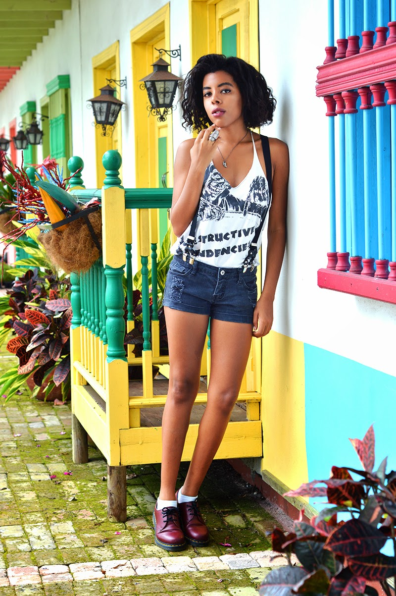 Miami Fashion Blogger Anais Alexandre of Down to Stars in an Obesity & Speed tank top with Forever 21 shorts and suspenders with vegan dr martens and Forever 21 jewelry