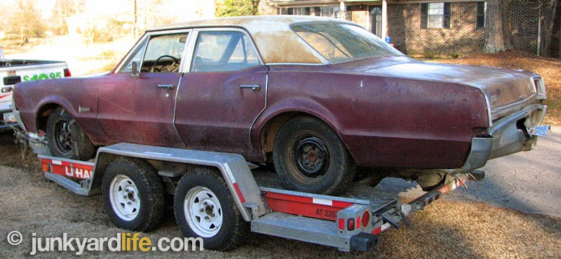 Rear view of Olds on trailer.
