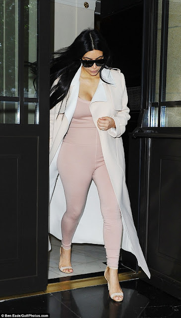 "Model Pregnant Kim Kardashian having stepped out in a pink mini dress and matching jacket to dine out in London on Sunday. She must have liked her look so much on Sunday evening, that she wore something very similar the morning after. The 34-year-old continued to wear the same long-length coat the next morning. Scroll Down for the video clips ""Pregnant Kim Kardashian and sister Kylie Jenner hit Cannes Lions festival after party""."