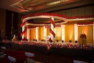 Wedding reception stage decor at crowne plaza hotel cochin