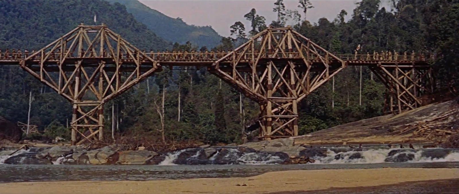 the bridge on the river kwai The bridge on the river kwai the bridge on the river kwai is a character driven war drama about a men with principles standing against the antagonist's camp as a protest with a never yielding spirit the self-righteousness and morale a calculative allegory that symphonizes higher concept.