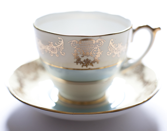 gold and blue vintage teacup