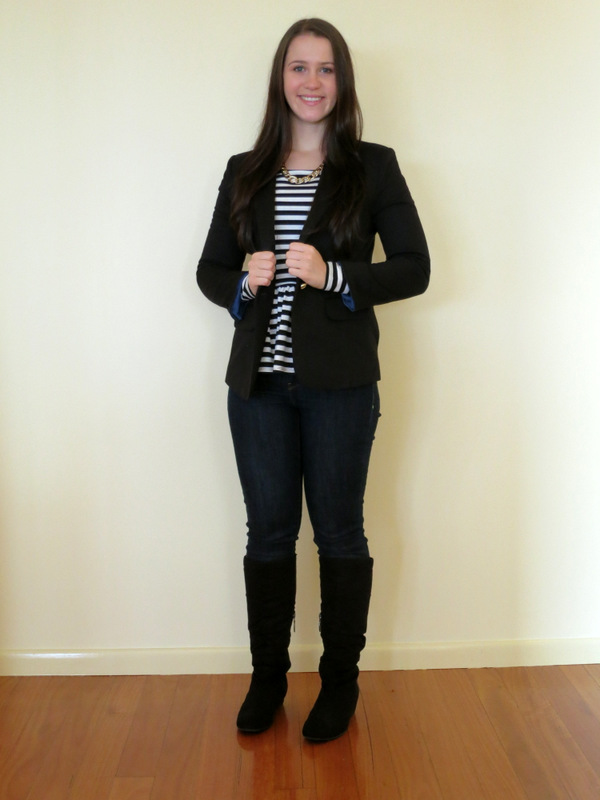 Dark wash denim jeans, stripey peplum top, black boots with a black blazer and gold necklace
