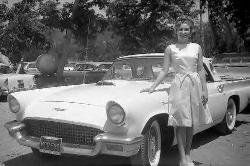 Posing with her 1957 T-Bird