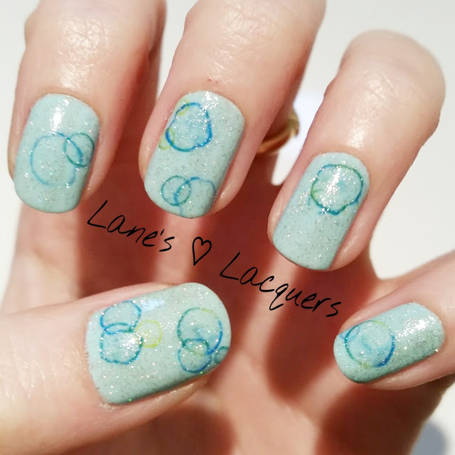 40-great-nail-art-ideas-glitter-topper-water-decals-bubble-nails (1)