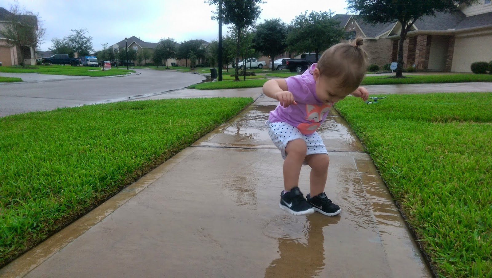 Toddler playing in rain | Bubbles and Gold (www.bubblesandgold.com)