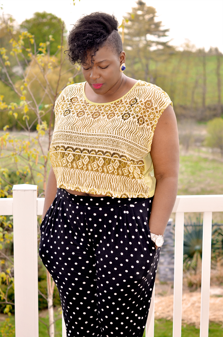 Plus size girl wearing a crop top and polka dots pants from Asos curve