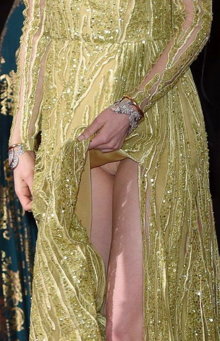Emma Stone suffers an upskirt moment at the 2015 Oscars in Hollywood