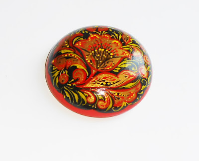 The wooden brooch with the author's hand-painted in Russian style khokloma handmade.