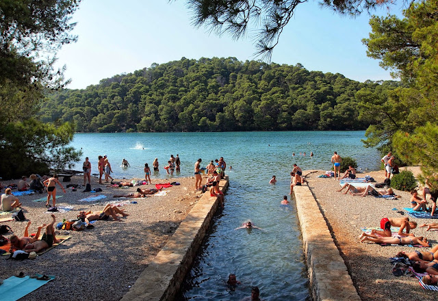 Tourists swimming in Small Lake, Mljet National Park, Croatia