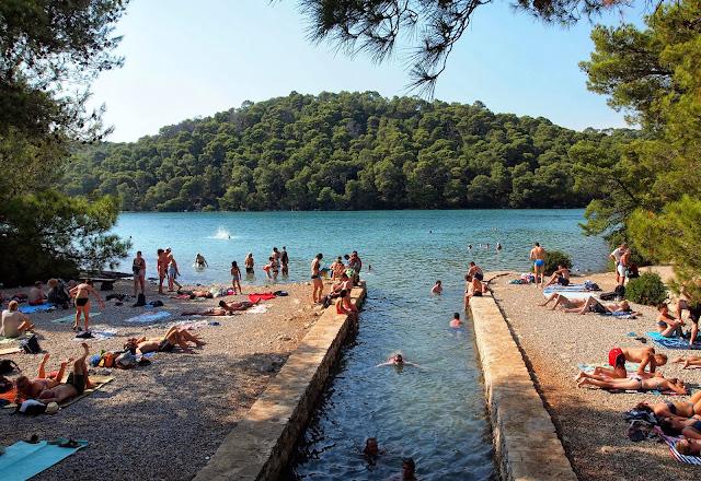 Tourists swimming in Small Lake, Mljet National Park, Croatia