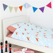 Union Jack and Jill Red Plane Cotbed/Junior Duvet Cover. Shown on a bed.