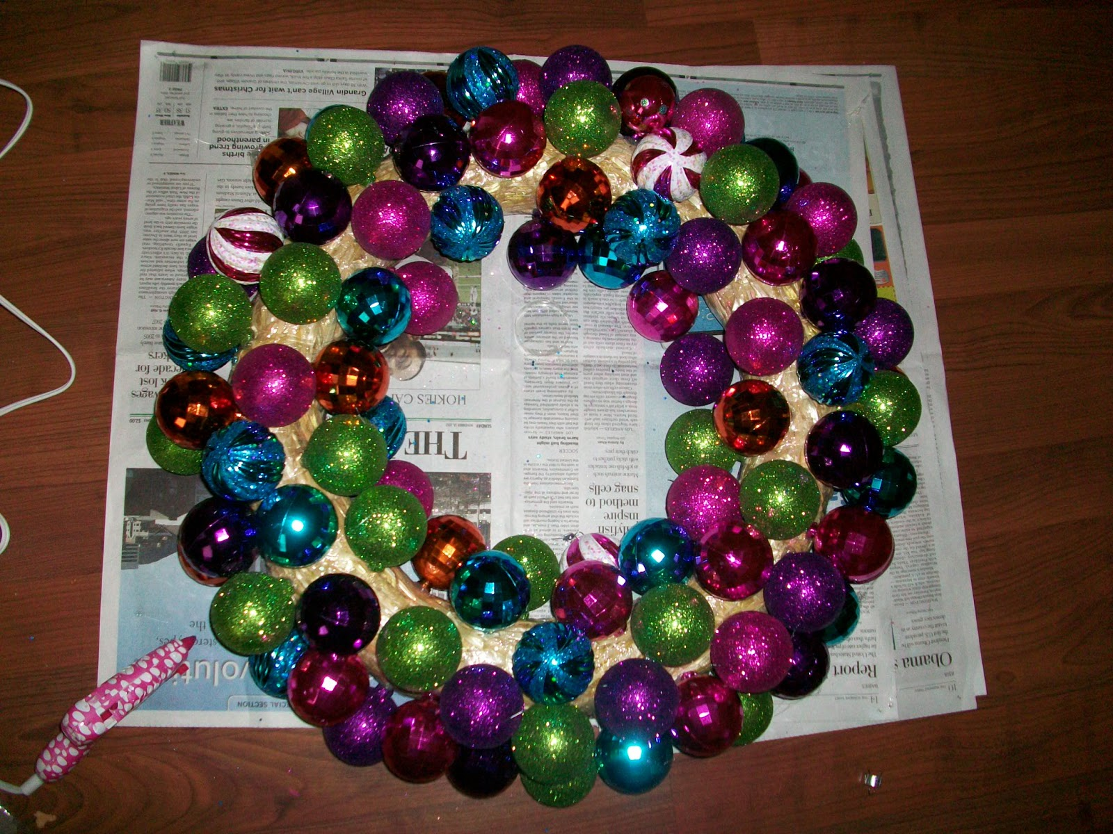 August morning ornament wreath diy then start filling in with your smaller ornaments to keep the wreath looking round dont cram them all the way down to the surface of the straw base solutioingenieria Choice Image