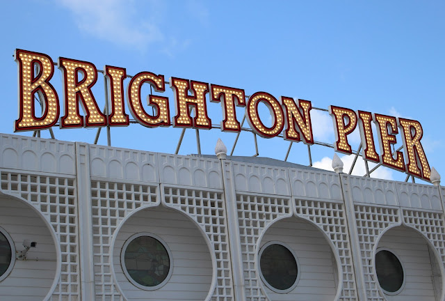 Brighton pier sunny summer sign