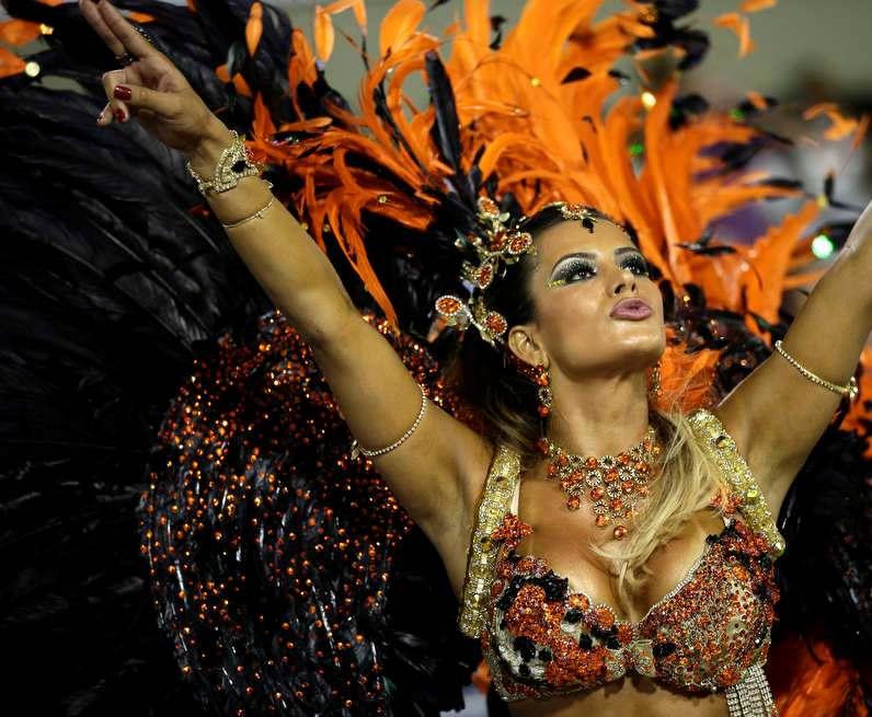 Drum queen Lucilene Caetano, from Inocentes de Belford Roxo samba school, dances during a carnival parade at the Sambadrome in Rio de Janeiro, Brazil, Sunday, Feb. 10, 2013. AP / Silvia Izquierdo.