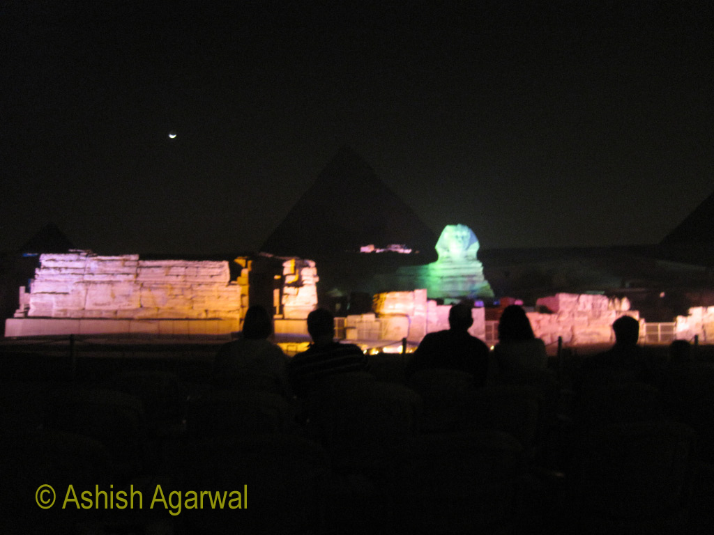 A distant view of the Great Sphinx and the Great Pyramid at night, with a Sound and Light show