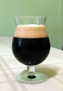 A tulip of sour bourbon barrel porter.