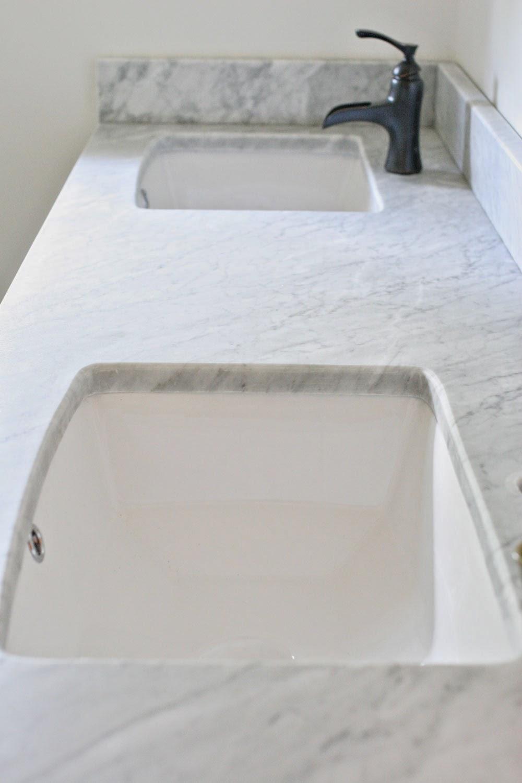 Craftivity designs bathroom renovation honed carrara for How to hone marble