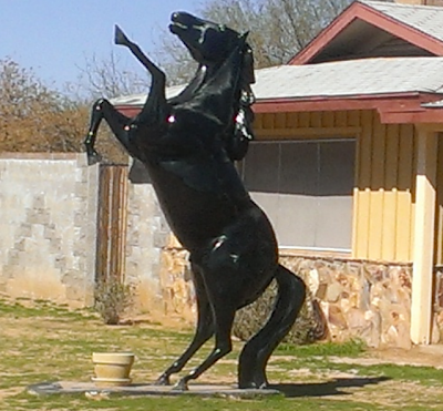 statue of horse rearing in front of home