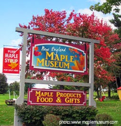 Maple Museum Sign with trees with red leaves surrounding