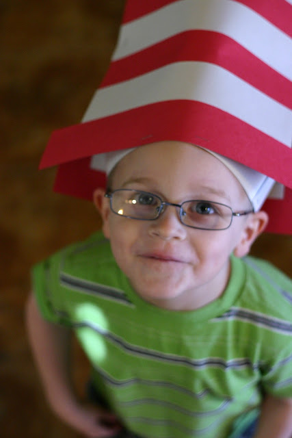 Candid portrait of a young child wearing a Dr. Seuss Hat