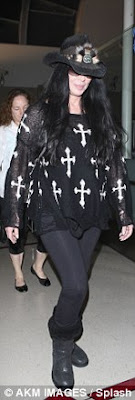 Cher cheerful at the Los Angeles Airport