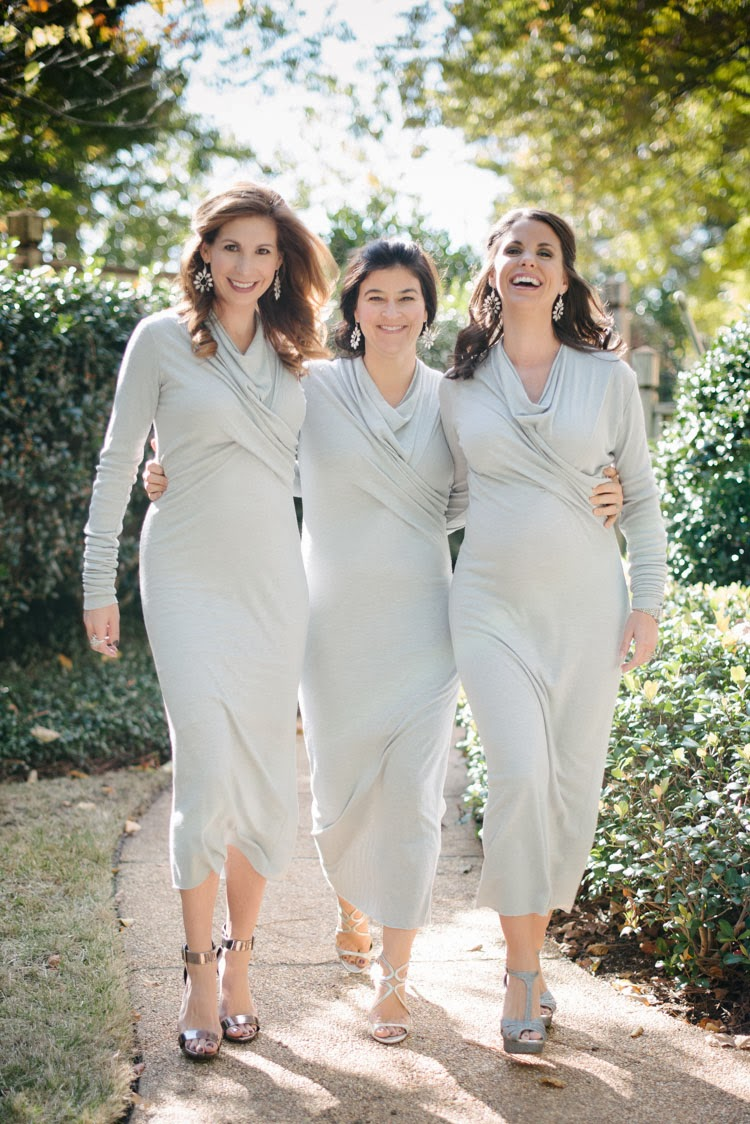 Bridesmaids together wearing blue gray Rick Owens Lilies dress and smiling