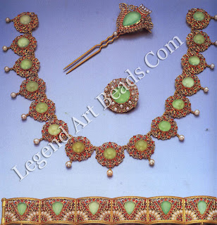 A parure of openwork gold jewelry in the Indian taste, set with chrysoprase, rubies and pearls.