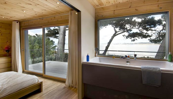 Honka fusion log house in brittany france interior - Range bois interieur maison ...