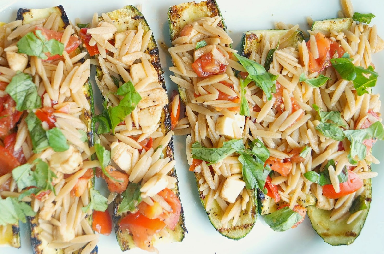 Grilled Zucchini Stuffed with Caprese Orzo
