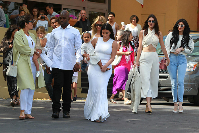 Kim Kardashian wears a white gown coordinates with daughter North West wearing a flower crown and Kris Jenner, Kylie Jenner, Kendall Jenner and Khloe Kardashian in all white fashion for an Easter church mass service