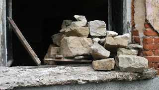 Stacking rocks from the interior wall