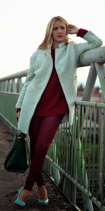 White Long Coat, Auburn Sweater With Burgundy Pent And Cadet Blue Heel