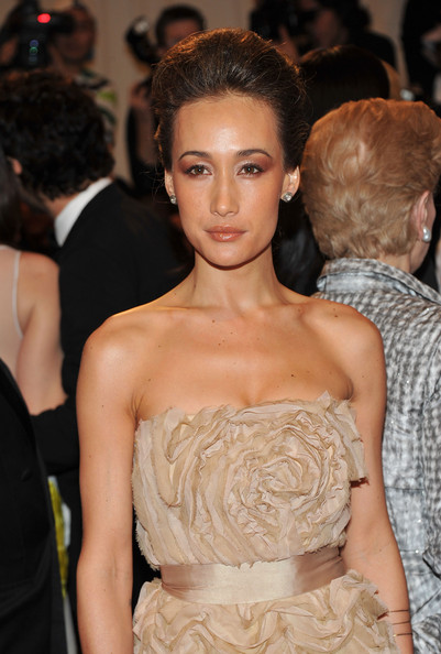 "Maggie Q in a champagne-hued Tadashi Shoji strapless soft floral gown with a satin accent emphasizing her waist at the ""Alexander McQueen: Savage Beauty"" Costume Institute Gala held at The Metropolitan Museum of Art on May 2, 2011 in New York City."