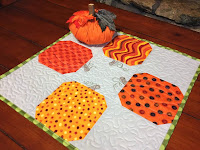 http://www.sassyquilter.com/pumpkin-table-topper-tutorial/