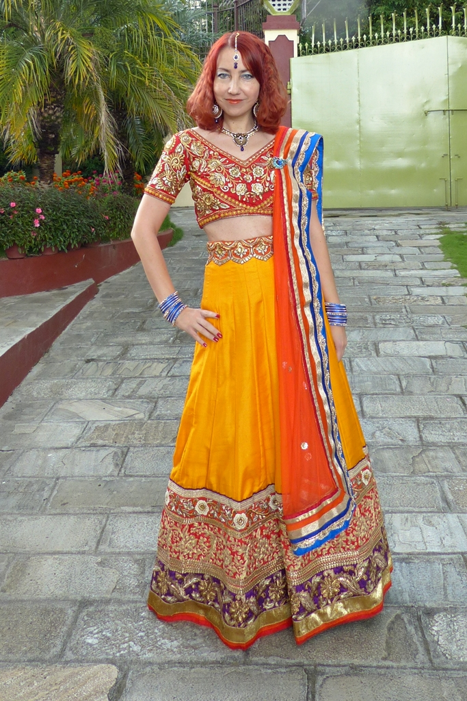 Lehenga choli party outfit worn with peacock theme jewelry