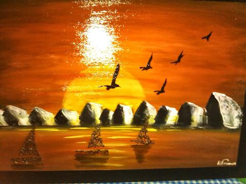 por do sol com barcos em relevo