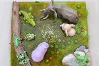 http://funprojectsforyourkids.blogspot.com/2015/06/african-swamp-sensory-bin.html