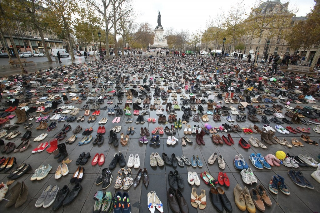 70 Of The Most Touching Photos Taken In 2015 - Shoes are left in the place of climate activists after a COP21 march in Paris was cancelled for security reasons.