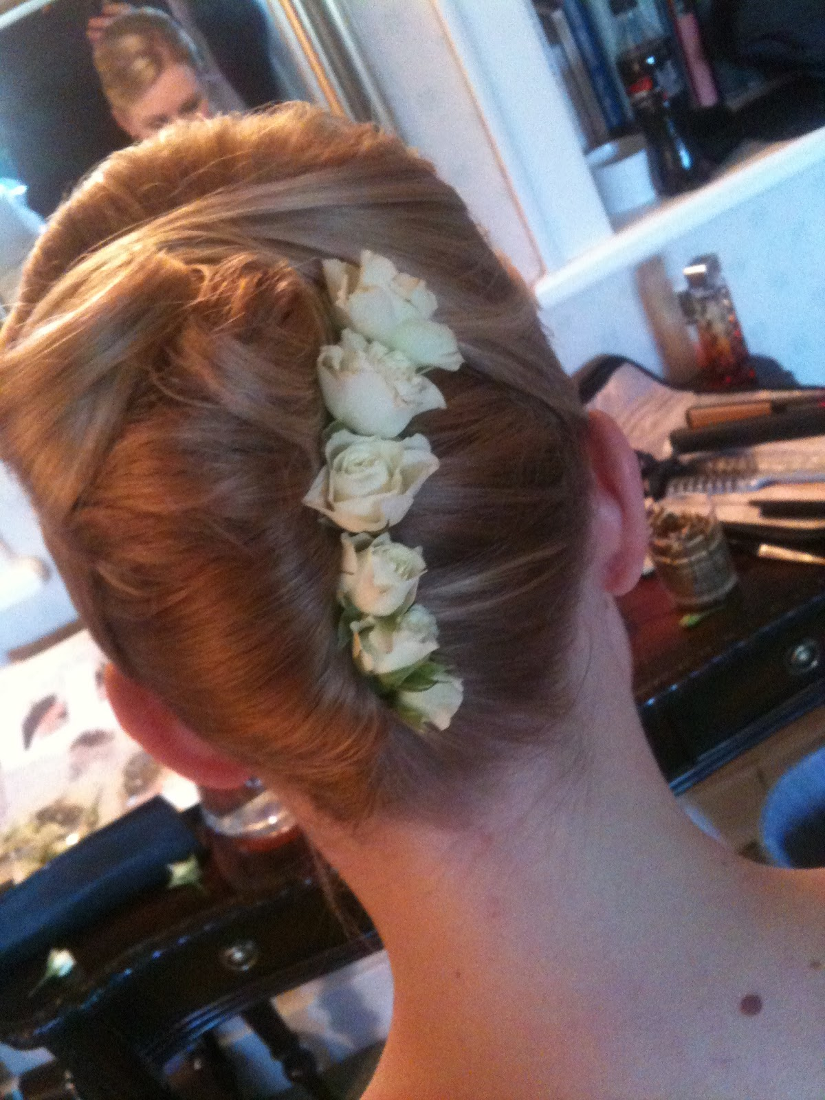 the bridesmaids hair, both bridesmaids had asked for a french roll