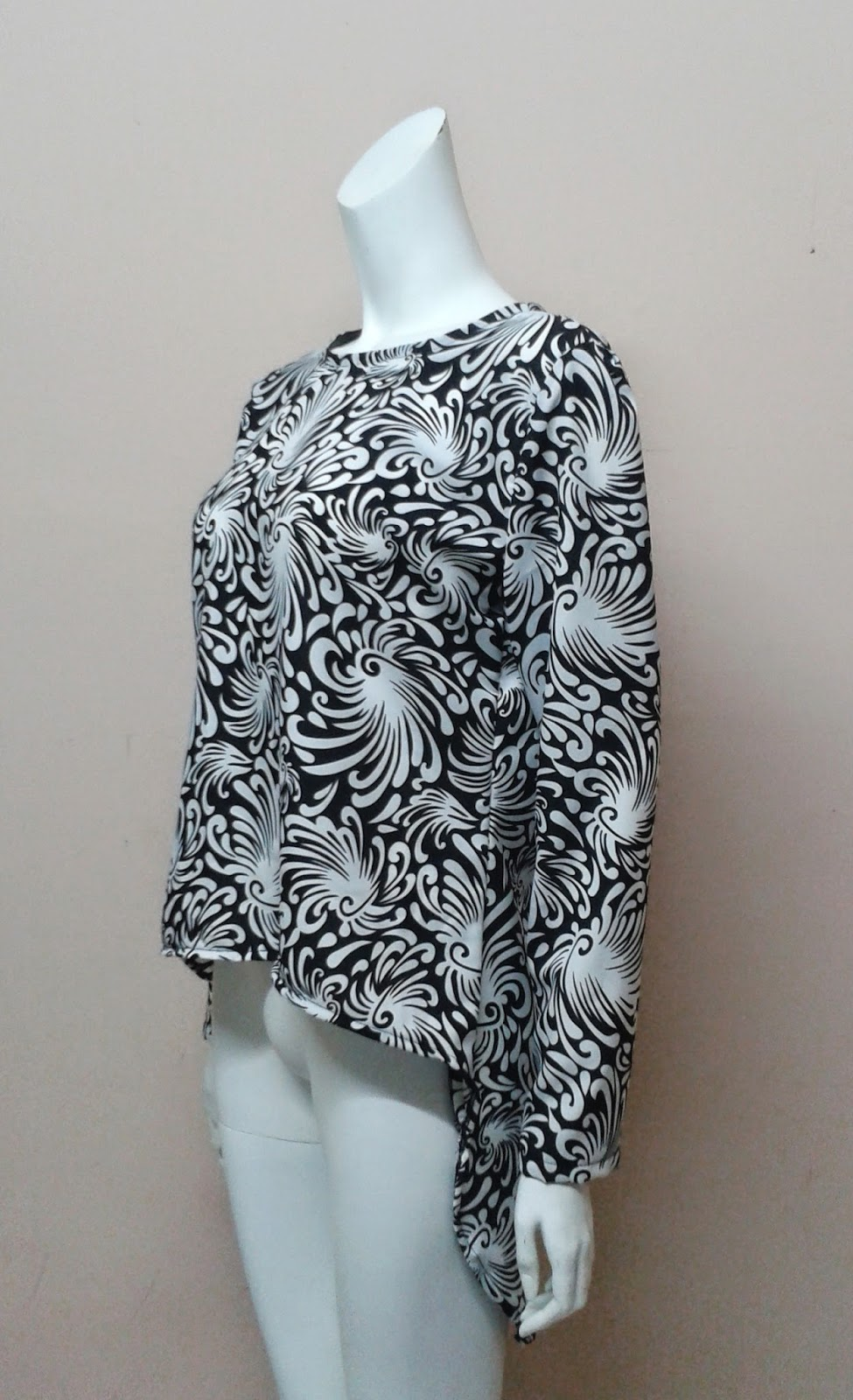 http://dzethiniecouture.wix.com/dzethiniecouture#!product/prd1/1975967545/spiral-printed-fishtail-blouse