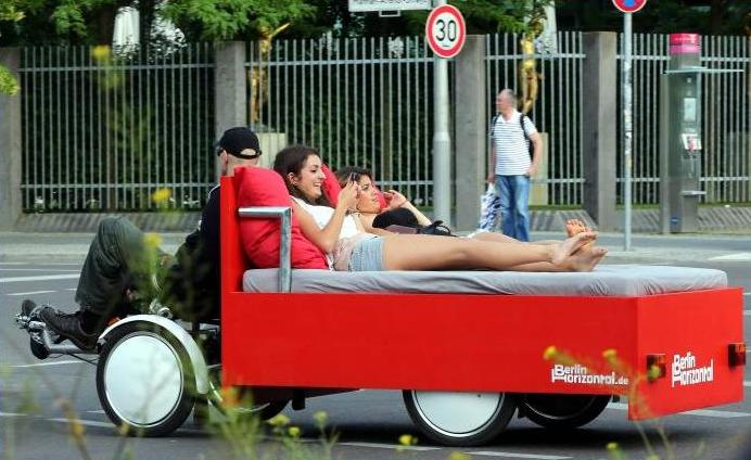 Two women being driven on a 'Bettbike' (bed bike) through Berlin, Germany, on Wednesday. Entrepreneur Richard Eckes and his company Berlin Horizontal offer tours around the capital on the new rickshaw. A one-hour tour costs 45 euros (S$74).