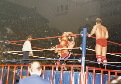 Ray Rougeau takes Bret Hart down with a flying cross body as Jacques, Jr. stands on the ring apron and ref Danny Davis prowls around the wrestling ring at Maple Leaf Gardens on December 26, 1986.