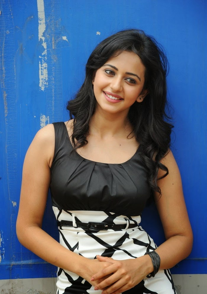 Rakul Preet Singh wearing a black mini skirt with a black belt hot panty pics sexiest shocking sexy exposing young bollywood actress