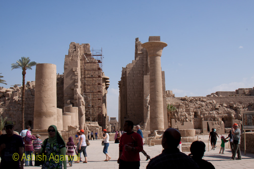 View of people standing in front of the huge structure of the Karnak temple in Luxor