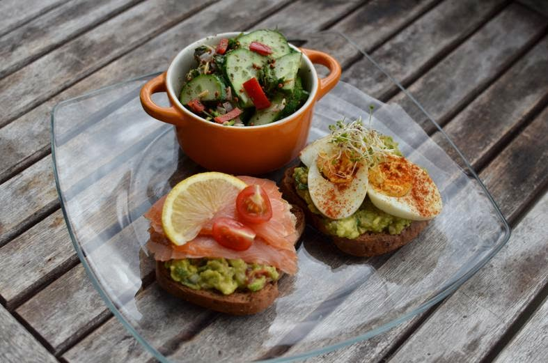 Recipe Toasts with homemade guacamole, salmon, and eggs