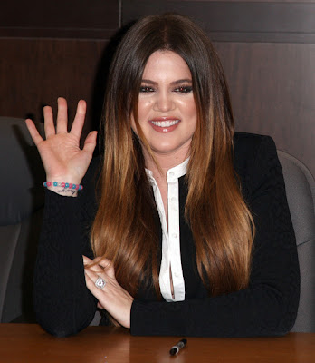 Khloe Kardashian Long Center Part Hairstyle Photo