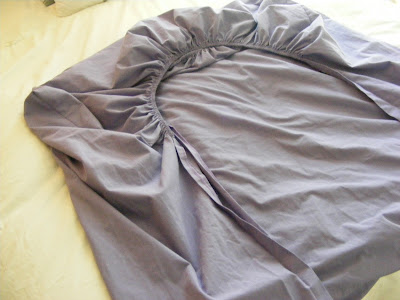 4 ways to fold bedsheets the complete guide to imperfect How to put a fitted sheet on a bed