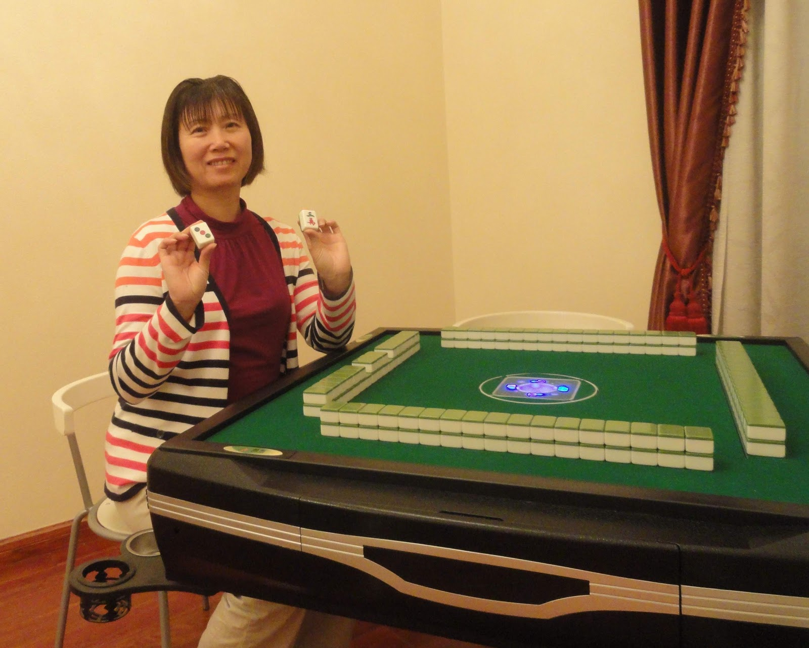 "Tina playing the Chinese game ""Mahjong"" at her brother's house"