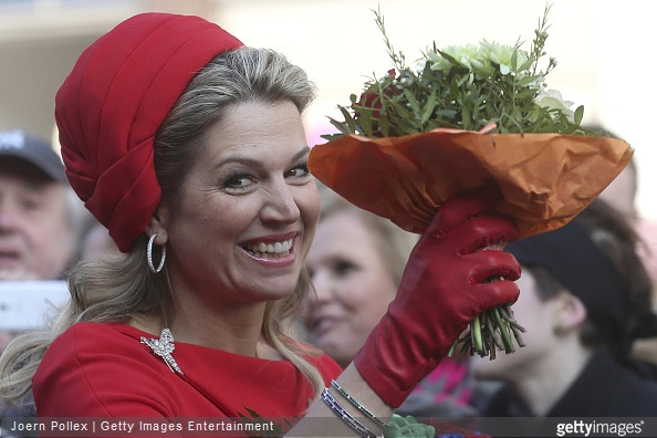 Queen Maxima of the Netherlands waves to the citizens at the town hall during her and King Willem-Alexander of the Netherlands state visit